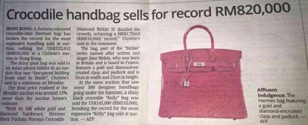 このバッグは香港オークションで買った....値段はマレーシア通貨 RM820,000 !!! つまり 22788362.79 日本円 !!!